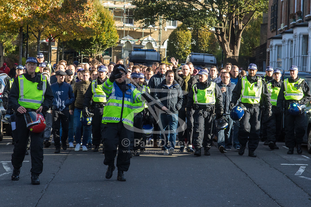 Emirates Stadium, London, November 6th 2016. Police escort a contingent of Spurs fans at Drayton Park as crowds arrive for the North London derby between Arsenal and Tottenham.