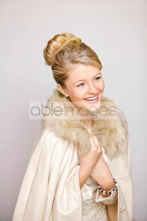Smiling Woman in Fur Trim Coat