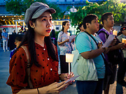 12 AUGUST 2018 - BANGKOK, THAILAND: People honor the Queen Mother during a candlighting ceremony to honor the 86th birthday of Sirikit, the Queen Mother of Thailand at EmQuartier Mall in Bangkok. She was the wife of Bhumibol Adulyadej, the late King, and she is the mother of His Majesty King Maha Vajiralongkorn Bodindradebayavarangkun of Thailand, who succeeded his father. August 12 is also celebrated as Mother's Day in Thailand.    PHOTO BY JACK KURTZ