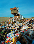 Dustcart emptying rubbish at a domestic landfill site.<br /> <br /> Britain has one of the lowest recycling rates in Europe.