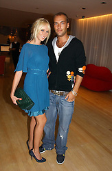 KIMBERLEY STEWART and CALUM BEST at a party to celebrate the launch of Amy Sacco's book 'Cocktails' held at Sanderson, 50 Berners Street, London W1 on 10th July 2006.<br /><br />NON EXCLUSIVE - WORLD RIGHTS