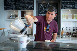 LEXINGTON, Ky., -- Nate Polly owner of Nate's Coffee a small batch coffee roaster makes a cup if coffee in a Clever brand Coffee Dripper, Monday, Sept. 25, 2017 at the Nate's Coffee in LEXINGTON.