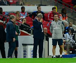England Manager, Roy Hodgson looks a frustrated figure with England coach, Gary Neville - Photo mandatory by-line: Joe Meredith/JMP - Mobile: 07966 386802 - 3/09/14 - SPORT - FOOTBALL - London - Wembley Stadium - England v Norway - International Friendly