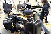 private elementary school kids entering the subway Tokyo Japan