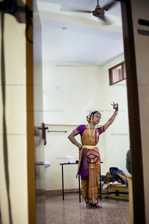 Laksha, an Aravani kuchipudi dancer prepares for a performance in Chennai...India's transexual community has a recorded history of more than four thousand years. Many consider the The Third Sex, also known as Aravanis, to posses special powers allowing them to determine the fate of others. As such, they are not only revered but despised and feared too. Resigned to the fringes of society, segregated and excluded from most occupations, many Aravanis are forced to turn to begging and sex work in order to earn a living. ..The annual transgender festival in the village of Koovagam, near Vilappuram, offers an escape from this often desolate existence. For some, the week-long partying and frenetic sex trade that culminates in the Koovagam festival is about fulfilling lustful desires. For others, the gathering provides a chance for transgenders to bond, share experiences, join the wider homosexual gay-community and coordinate their campaign for recognition and tackle the challenge of HIV/AIDS. ..It is the Indian state of Tamil Nadu that the eighty-thousand-strong Aravani community has made advances in their fight for rights. In 2009, the Tamil Nadu state government began providing sex-change surgery free of cost. The state has also offers special third-gender ration cards, passports and reserved seats in colleges. And 2008 the launch of Ippudikku Rose, a Tamil talk-show fronted by India's first transgender TV-host and the release of a mainstream Tamil film staring an Aravani in the lead-role. ..These advances clearly signal a victory for south India's transgenders, but they have also exposed deep divisions within the community. There is a very real gulf that separates the majority poor from their potentially influential but often reticent, upper-class sisters. ..Photo: Tom Pietrasik.Chennai, Tamil Nadu. India.May 2009