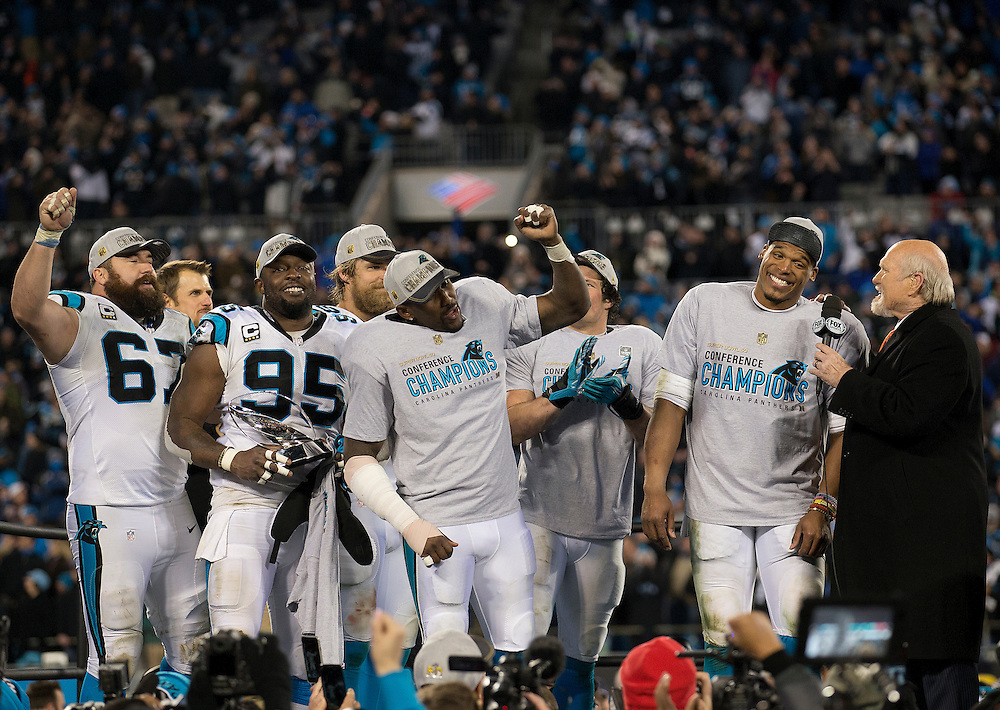 "CHARLOTTE, NC - JAN 24:  Members of the Carolina Panthers lead an ""MVP"" chant for quarterback Cam Newton #1 during his interview with Fox Sports analyst Terry Bradshaw after the NFC Championship game against the Arizona Cardinals at Bank of America Stadium on January 24, 2016 in Charlotte, North Carolina."