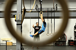 Gavin Young instructeur Yun Li ahead of a work out during a session of Phoenix Multisports at Fearless Athletics, in South Philadelphia, on October 8, 2016. (Bastiaan Slabbers / for phillyvoice)