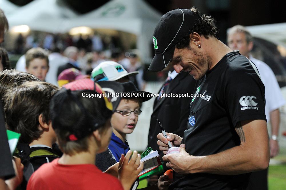Kyle Mills signs autographs after winning the 2nd International Twenty-20 cricket match, New Zealand vs Zimbabwe, Seddon Park, Hamilton, New Zealand, 14 February 2012. Photo: Owen Harrison/photosport.co.nz