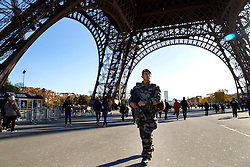 © Licensed to London News Pictures. 15/11/2015. Paris, France. French soldiers patrolling the Eiffel Tower in Paris, France following the Paris terror attacks on Sunday, 15 November 2015. Photo credit: Tolga Akmen/LNP