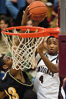 JEROME A. POLLOS/Press..North Idaho College's Melvin Jones goes up for a shot against Kevin Galloway, from College of Southern Idaho, during the first half of Saturday's game.