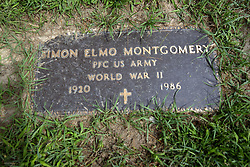 31 August 2017:   Veterans graves in Park Hill Cemetery in eastern McLean County.<br /> <br /> Simon Elmo Montgomery  Private First Class US Army  World War II  1920  1986