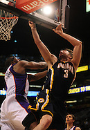 Mar. 6 2010; Phoenix, AZ, USA;  Indiana Pacers forward Troy Murphy (3) drives the ball against Phoenix Suns forward Amare Stoudemire (1) in the first half at the US Airways Center.  Mandatory Credit: Jennifer Stewart-US PRESSWIRE