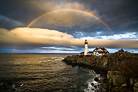 A full rainbow appears over one of Maine's most recognizable landmarks, Portland Head Light in Cape Elizabeth.