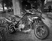 Movie Motorcycles. Morning Street Photography in Lisbon. Image taken with a Leica CL camera and 23 mm f/2 lens.