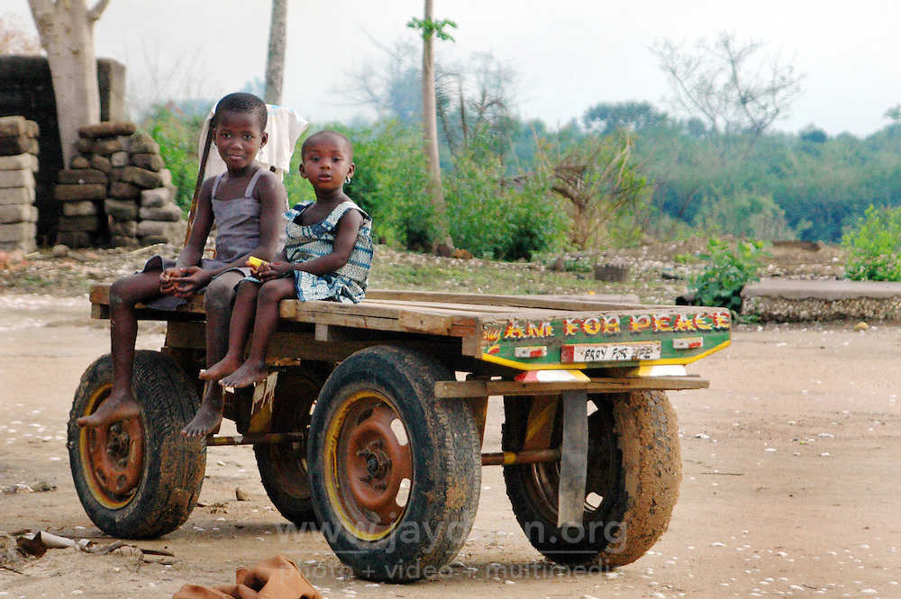 Ghana, Adaklu, Titikope, 2007. Children play on an idle farm vehicle. The majority of Ghanaians are involved in agriculture.