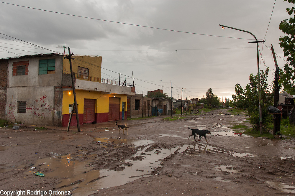 General view of one of the main streets of Ocho de Mayo, an informal settlement in the district of General Saint Mart&iacute;n, Buenos Aires, Argentina, in January 2006. The neighborhood is named after the date in which the first settlers moved in, on the 8th of May of 1998. <br /> Today, Ocho de Mayo is home to about 1,500 families, many of them young. Of the 5,000 residents, 3,000 are under 16. About 65 percent of the population is Paraguayan. The rest are from nearby towns or elsewhere in Argentina. This neighborhood does not look very different from the villas miseria &mdash;slums or shantytowns&mdash; that ring the Argentine capital.