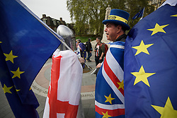 © Licensed to London News Pictures. 23/04/2019. London, UK. A Pro EU campaigner, dressed as St. George (left), the patrol saint of England, tams to Pro EU activist STEVE BRAY (right), outside The Houses of Parliament in London on St. George's Day.. Number 10 will continue talks with labour today in an attempt to reach a compromise on the withdrawal agreement from the EU. Photo credit: Ben Cawthra/LNP