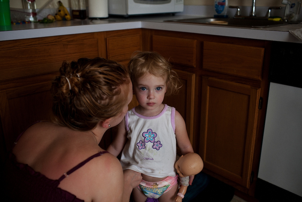 Melissa Eich, 22, cares for her daughter Madelyn, 2, after she awakes from a nap in Norfolk, Virginia on Sunday, May 2, 2010.