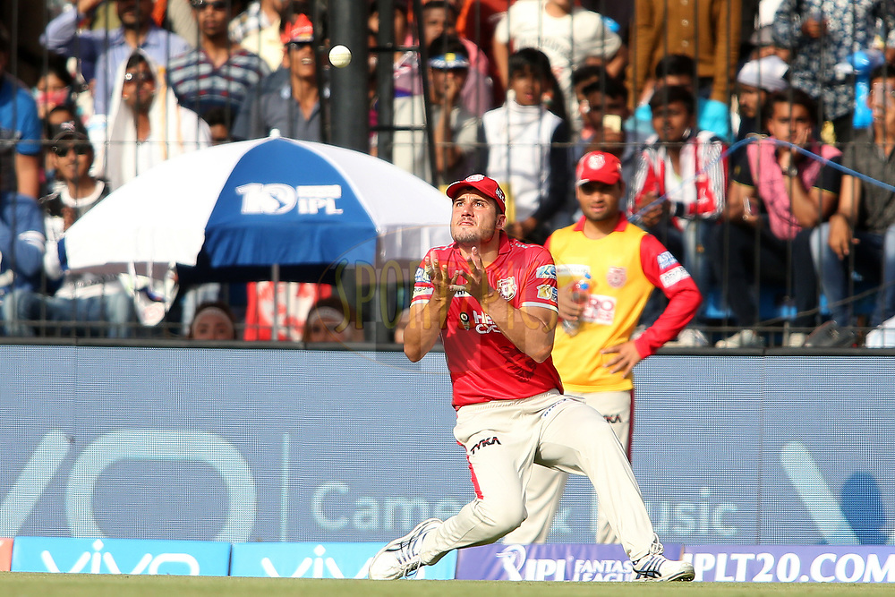 Marcus Stoinis of Kings XI Punjab gets under the ball to take the catch to get Ajinkya Rahane of Rising Pune Supergiant wicket during match 4 of the Vivo 2017 Indian Premier League between the Kings XI Punjab and the Rising Pune Supergiant held at the Holkar Cricket Stadium in Indore, India on the 8th April 2017<br /> <br /> Photo by Shaun Roy - IPL - Sportzpics