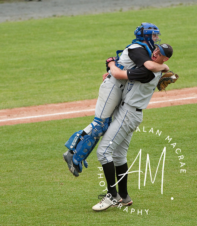 Winnisquam's Jordan Cote hugs catcher Cody Smart following their win over Hopkinton in the NHIAA semi-finals at Concord's Memorial Field on Wednesday, June 9, 2010.  (Alan MacRae/for the Citizen)