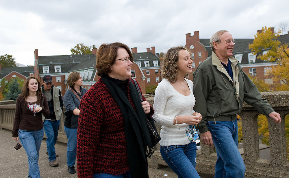 Walking from West Green to Court Street Emily Lambert, left, her daughter Julie a freshman, and husband Myron spend their weekend attending the Parents and Students weekend.