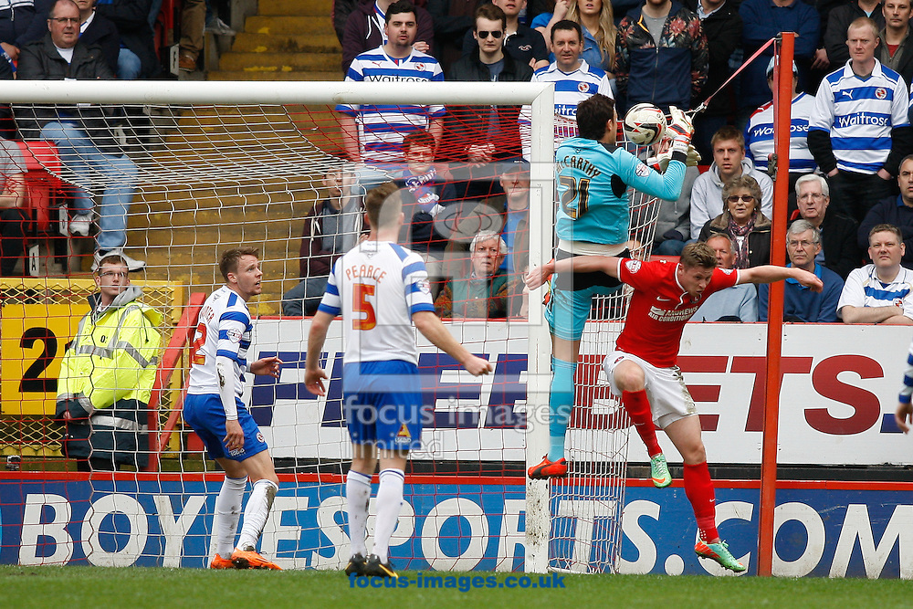 Alex McCarthy of Reading (top) catches a high ball challenged by ex Reading player Simon Church of Charlton Athletic (R) during the Sky Bet Championship match at The Valley, London<br /> Picture by Andrew Tobin/Focus Images Ltd +44 7710 761829<br /> 05/04/2014