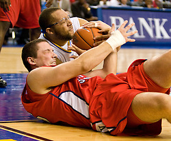 February 27, 2010; San Jose, CA, USA;  San Jose State Spartans forward C.J. Webster (22) and Fresno State Bulldogs forward Nedeljko Golubovic (15) battle for a loose ball during the first half at The Event Center.  San Jose State defeated Fresno State 72-45.