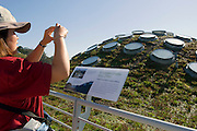 The roof on opening day at California Academy of Sciences.The California Academy of Sciences is a world-class scientific and cultural institution based in San Francisco. The Academy recently opened a new facility in Golden Gate Park, a 400,000 square foot structure that houses an aquarium, a planetarium a natural history museum and a 4-story rainforest all under one roof. The new facility was built by renowned architect Renzo Piano....Alternative Energy in Silicon Valley and the San Francisco Bay Area