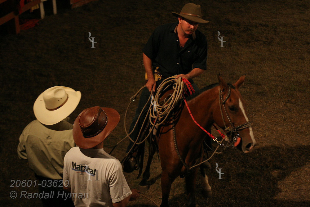 Cowboy with lasso rides horse at rodeo in Atenas, Costa Rica.