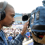 5/7/11 -- BATH, Maine. U.S. Navy Mass Communication Specialist 3rd Class Tristan Miller operates a video camera at the Christening ceremony of Aegis Destroyer Michael Murphy on Saturday, May 7, 2011 at Bath Iron Works. The 509-foot ship was named for Lieutenant Michael Murphy, whose bravery under fire in Afghanistan in June, 2005 led to the posthumous award of the Medal of Honor..The ceremony included speeches by Maine Governor Paul LePage, Chief of Naval Operations - Admiral Gary Roughead, Senator Olympia Snowe, Representatives Mike Michaud and Chellie Pingree as well as ship sponsor, Maureen and Dan Murphy, parents of Lieutenant Murphy. Photo by Roger S. Duncan.