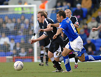 Photo: Ashley Pickering.<br />Ipswich Town v Swansea City. The FA Cup. 27/01/2007.<br />Swansea's Thomas Butler holds off Ipswich's Sito Castro
