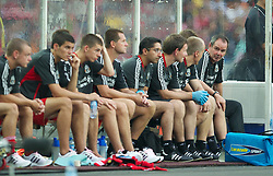 KUALA LUMPUR, MALAYSIA - Saturday, July 16, 2011: Liverpool's assistant manager Steve Clarke on the bench in place of the absent manager Kenny Dalglish against a Malaysia XI at the National Stadium Bukit Jalil in Kuala Lumpur on day six of the club's Asia Tour. (Photo by David Rawcliffe/Propaganda)