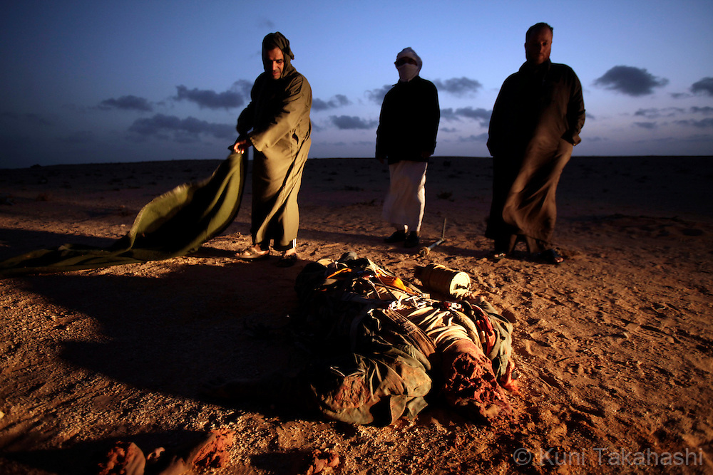A body of pilot of Col. Muammar Gaddafi's Air Force fighter jet lies on the ground in As Sider on March 5, 2011 after the jet was allegedly shot down by rebel militia..Photo by Kuni Takahashi