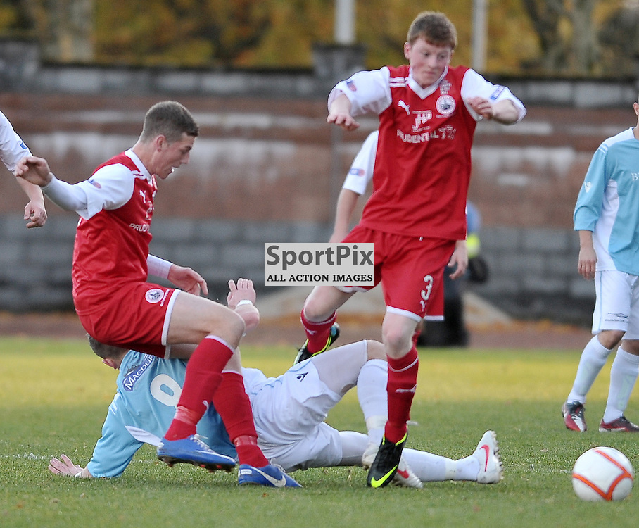 Criag Cowie (Deveronvale, blue) is booked for a late tackle..Stirling Albion v Deveronvale, William Hill Scottish Cup Third Round, 3rd November 2012..(c)  Alex Todd | StockPix.eu