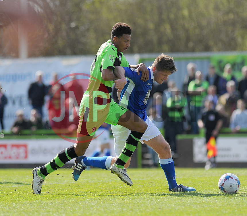 Forest Green Rovers's Kurtis Guthrie and Macclesfield Town's Alex Grant battle for the ball - Photo mandatory by-line: Nizaam Jones - Mobile: 07966 386802 - 11/04/2015 - SPORT - Football - Nailsworth - The New Lawn - Forest Green Rovers v Macclesfield Town - Vanarama Football Conference
