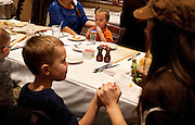 Hagen Dickinson, center, enjoys his juice as Taryn Nielsen feeds her son Spencer in the foreground during lunch at BRIO Tuscan Grill in Murray, Friday, Nov. 9, 2012.