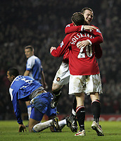 Photo: Paul Thomas.<br /> Manchester United v Wigan Athletic. The Barclays Premiership. 26/12/2006.<br /> <br /> Ole Gunnar Solskjaer celebrates (20) his goal for Man Utd with Wayne Rooney.