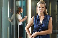 Businesswoman standing in office corridor portrait
