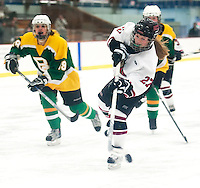 Annie Mullen makes the shot to score a goal for Concord against Bishop Guertin Saturday afternoon at Everett Arena.  (Karen Bobotas/for the Concord Monitor)