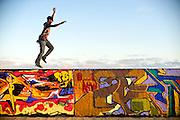 Curtis Parks runs along the Venice Beach graffiti walls in Venice, Calif.