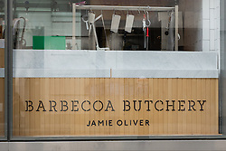 "© Licensed to London News Pictures. 09/05/2014. London, UK. A general view of Jamie Oliver's butcher's shop, Barbecoa Butchery near St Paul's Cathedral in London. Barbecoa Butchery shop has reopened after closing its doors for 24 hours after public health officers scored it one out of five in an inspection in January and said ""major improvement was necessary."" Photo credit : Vickie Flores/LNP"