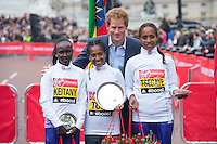 Elite Womens Winner Tigist Tufa is joined by HRH Prince Harry with 2nd place Mary Keitany and 3rd place Tirfi Tsegaye during The Virgin Money London Marathon, Sunday 26th April 2015.<br /> <br /> Photo: Jon Buckle for Virgin Money London Marathon<br /> <br /> For more information please contact Penny Dain at pennyd@london-marathon.co.uk