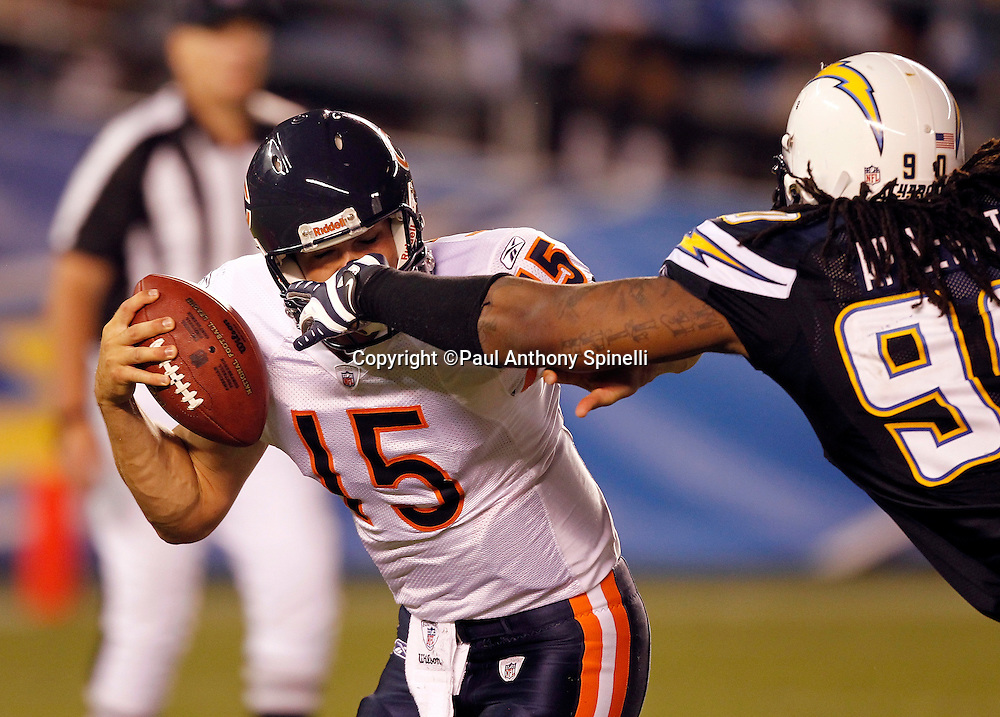 Chicago Bears rookie quarterback Dan LeFevour (15) tries to elude a sack and a face mask grab by San Diego Chargers linebacker Antwan Applewhite (90) during a NFL week 1 preseason football game against the San Diego Chargers, Saturday, August 14, 2010 in San Diego, California. The Chargers won the game 25-10. (©Paul Anthony Spinelli)