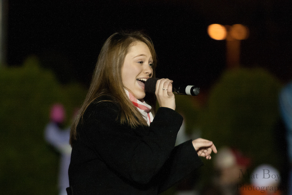 Alexa Ginotti of the Harmony Show Choir from the Mainstage Center for the Arts sings before the Christmas tree lighting at Gloucester Township Municipal Building on December 11th, 2010.