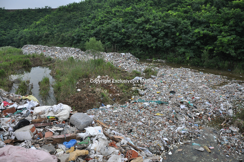 SUZHOU, CHINA - JULY 04: <br /> The lake bank is covered with waste at Taihu National Tourism Vacation Zone on July 4, 2016 in Suzhou, Jiangsu Province of China. Police seized 8 ships which loaded about 4,000 tons of suspected household garbage from Shanghai and arrived at a dock in Suzhou on July 1. Over 20,000 tons of waste was found on the bank within a drug rehabilitation center at the Suzhou Taihu National Tourism Vacation Zone.<br /> &copy;Exclusivepix Media