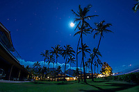 A full moon rises over Puamana resort on the island of Maui, HI, USA.