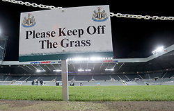 A Please Keep off The Grass sign pitch side prior to the match