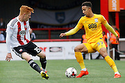 Preston North End forward Callum Robinson (37) looks to take on Brentford midfielder Lewis Macleod (4) during the EFL Sky Bet Championship match between Brentford and Preston North End at Griffin Park, London, England on 17 September 2016. Photo by Andy Walter.