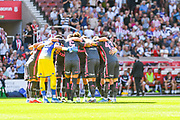 Leeds United players huddle during the EFL Sky Bet Championship match between Stoke City and Leeds United at the Bet365 Stadium, Stoke-on-Trent, England on 24 August 2019.