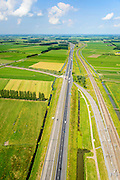Nederland, Gelderland, Geldermalsen, 26-06-2014; Autosnelweg A15 en Betuweroute tussen Meteren en knooppunt Deil. 0 aan de horizon).<br /> Motorway and freight railway, Central Holland. Both connecting port of Rotterdam with German hinterland.<br /> luchtfoto (toeslag op standard tarieven);<br /> aerial photo (additional fee required);<br /> copyright foto/photo Siebe Swart